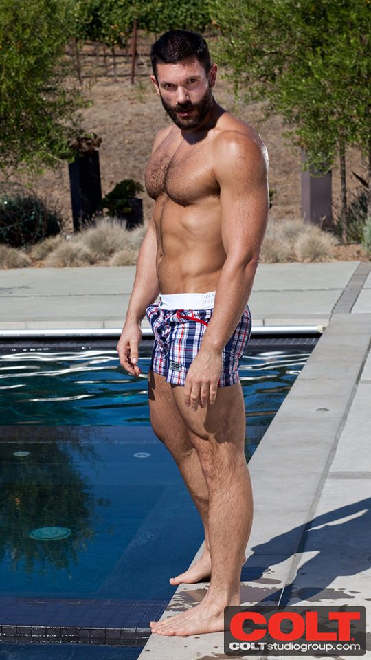 Wet muscled hunks by the pool